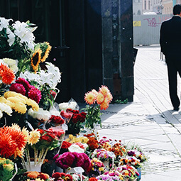 town flowers stand morning streets empty man walking suit travel real social UGC photography