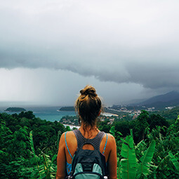 girl back-packer hiker view follow-me looking landscape water sea island volcano clouds tropical real UGC travel content photography