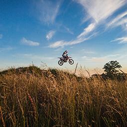 supermoto bike jumping endure field sky high sport motorbike Poland travel UGC content